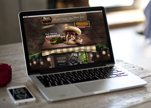 Hess's BBQ website on a laptop