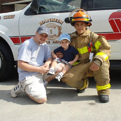 Tom and his son at the fire department